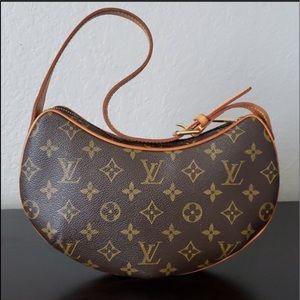Authentic Louis Vuitton.